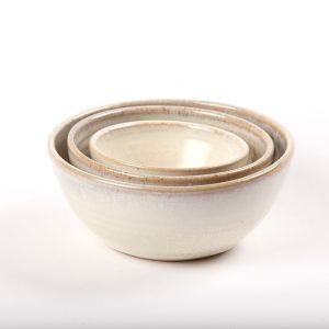 Nest of three white handmade bowls